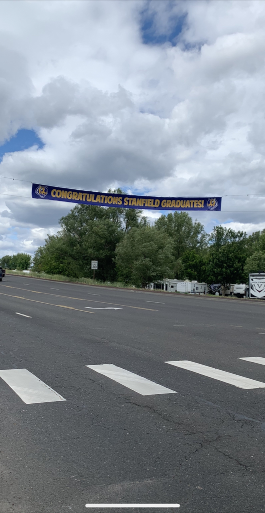 "Banner over roadway ""Congratulations Stanfield graduates""."