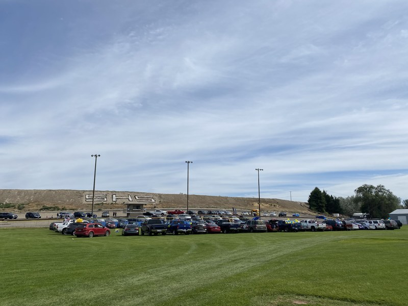 View of cars on football field for ceremony